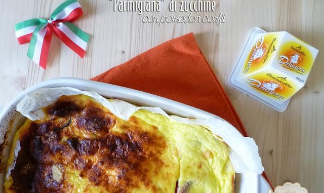 Parmigiana di zucchine con pomodori confit