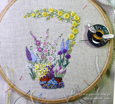 Purple flowers added to front of Lorna Bateman's embroidered scissors keeper design