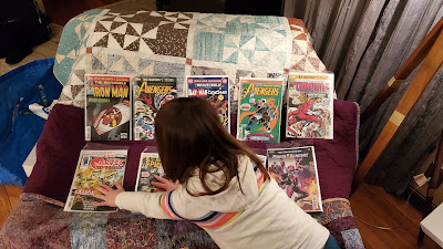 Library of Justice Assistant Librarian organizing comic books