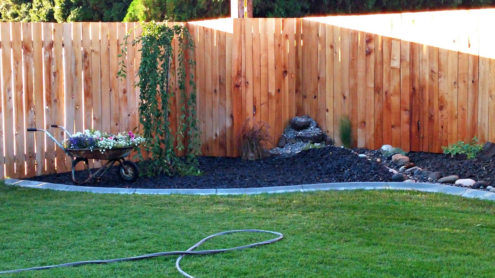 backyard landscaping progress dry river bed weekend yard work