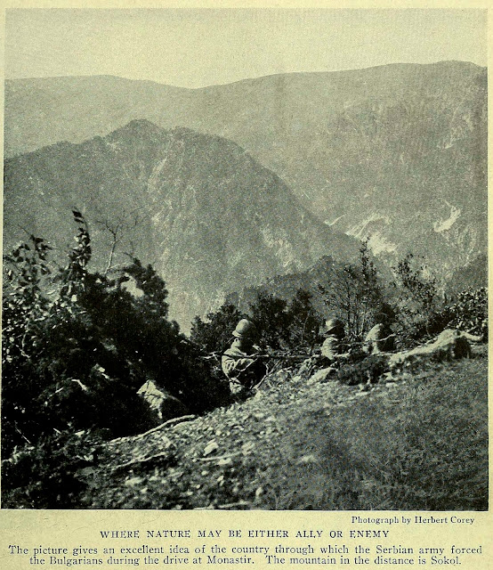 Photograph by Herbert Corey WHERE NATURE MAY BE EITHER ALLY OR ENEMY The picture gives an excellent idea of the country through which the Serbian army forced the Bulgarians during the drive at Monastir.  The mountain in the distance is Sokol.