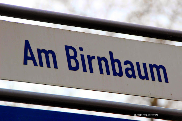 Street sign: Am Birnbaum.