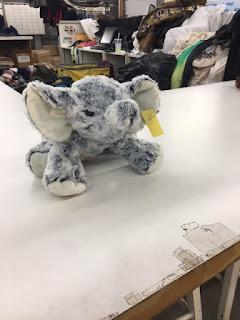 A small stuffed elephant on a countertop
