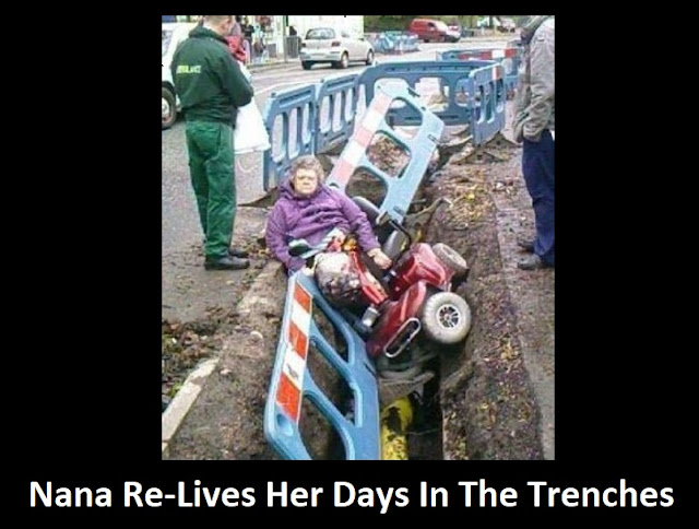 An elderly lady in a powered chair who fell in a trench