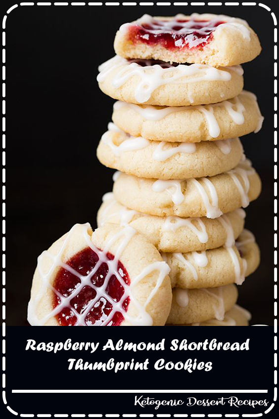 Raspberry Almond Thumbprint Cookies are one of the most popular recipes on my blog every Christmas season! You get a buttery shortbread cookie base, a bright, vibrantly flavored raspberry jam filling and they're finished with a sweet almond glaze. Simply put, they're addictively delicious!  #Chocolate #food #Dessert #Vegan #Healthy