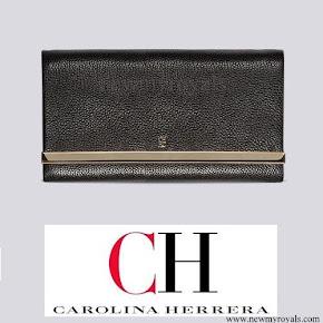 Queen Letizia carried Carolina Herrera clutch