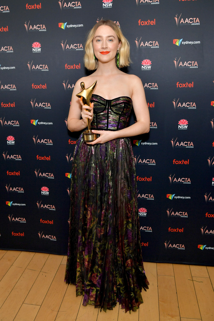 Saoirse Ronan is a sight to behold in strapless metallic gown with an orange red lip as she wins Best Actress at the AACTA Awards in LA