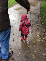Toddler splashing in puddles