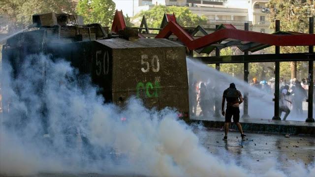 Chile se queda sin bombas lacrimógenas y las encarga a Brasil