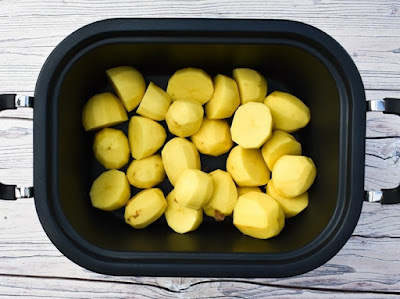 potatoes in slow cooker pan