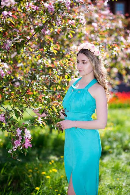 Woman at blossoming sakura tree on nature image