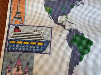 Cruise ship cross stitch on a travel themed cross stitch map