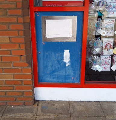 The QuikDrop slot is the only part of the former Blockbuster Video Express in Marple that hasn't been painted over. It's now a Post Office