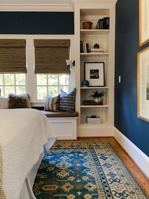 Newburyport Blue paint color on walls of bedroom by Benjamin Moore - Design by Sherry Hart. #newburyportblue #benjaminmoore #paintcolors #navybluepaint #bestnavyblue #interiordesign #bluebedroom