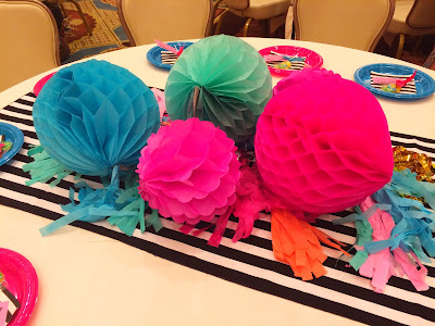 Combine beautful pops of color with striking stripes to create a fun table scape idea that's cheap and easy to replicate like Oriental Trading did at this SNAP luncheon.