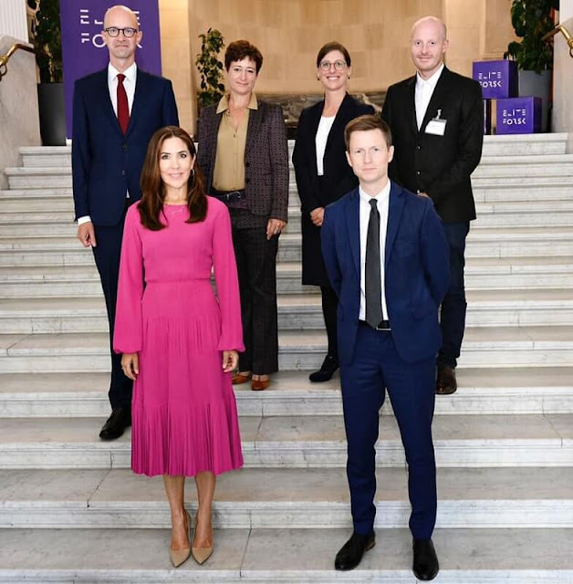 Crown Princess Mary wore a pink long sleeve pleated midi dress from No 21. Prada pumps