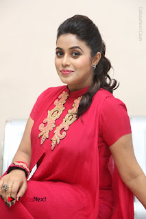 Actress Poorna Latest Stills in Red Dress at Rakshasi First Look Launch  0272.JPG