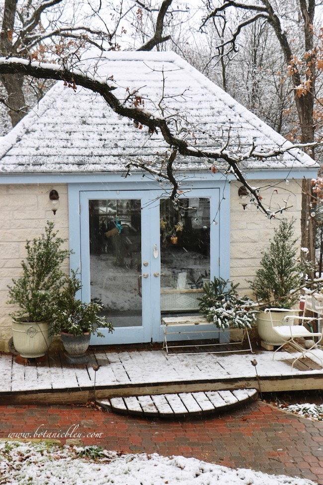 With snow , the shed is transformed into a blue and white winter scene