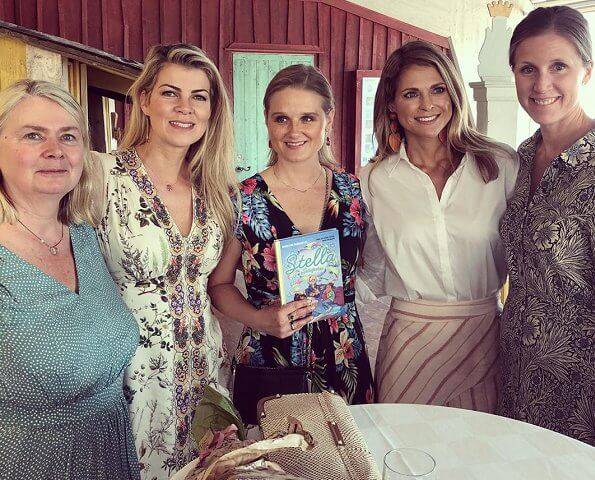 Princess Madeleine wor Aje Cora silk linen striped skirt. Stella and The Secret children's book.