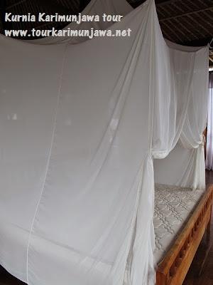 tempat tidur luar master suite nirwana resort karimunjawa