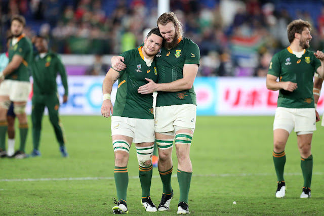Frans Louw and RG Snyman embrace after South Africa beat Wales in their World Cup semi-final