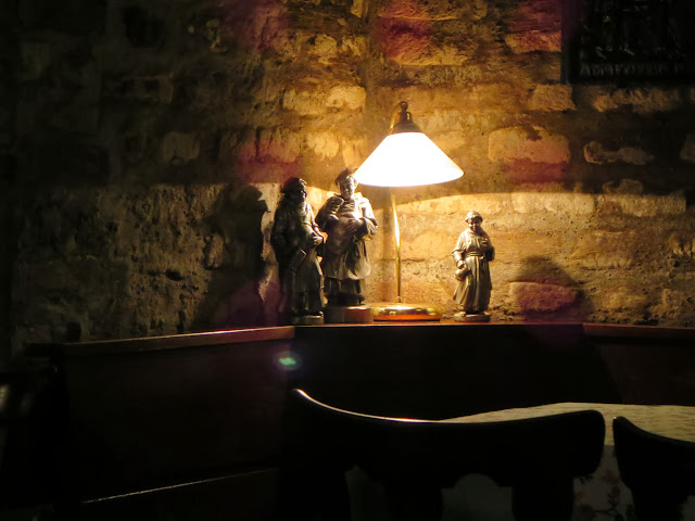 Statuettes in a wine bar in Speyer, Germany
