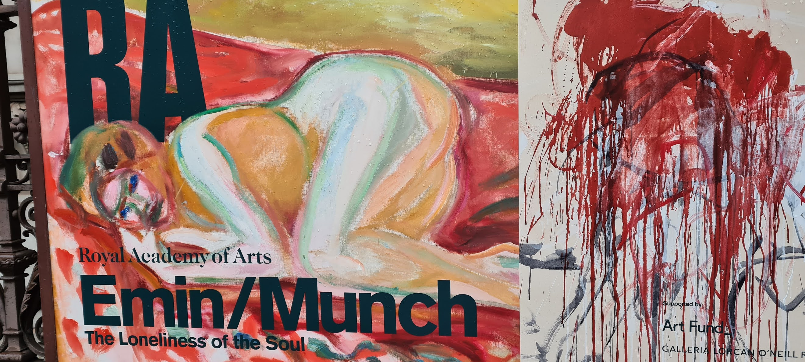 "Poster outside the Royal Academy in London advertising the Emin and Munch exhibition ""The Loneliness of the Soul."""