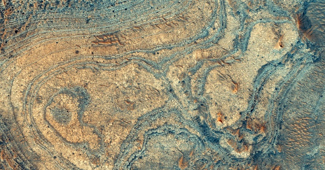 New research shows that a strange Martian mineral deposit, imaged here from orbit, was likely made by ashfall from ancient volcanic explosions. NASA