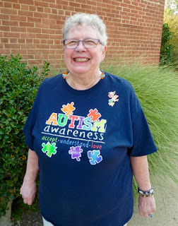woman wearing autism awareness t-shirt