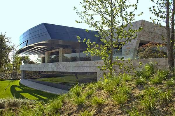 Futuristic Zen House Design Features A Facade Of Curved Walls Of Stone Dark Granite And Marble Travertine Top 7 Unique House Design