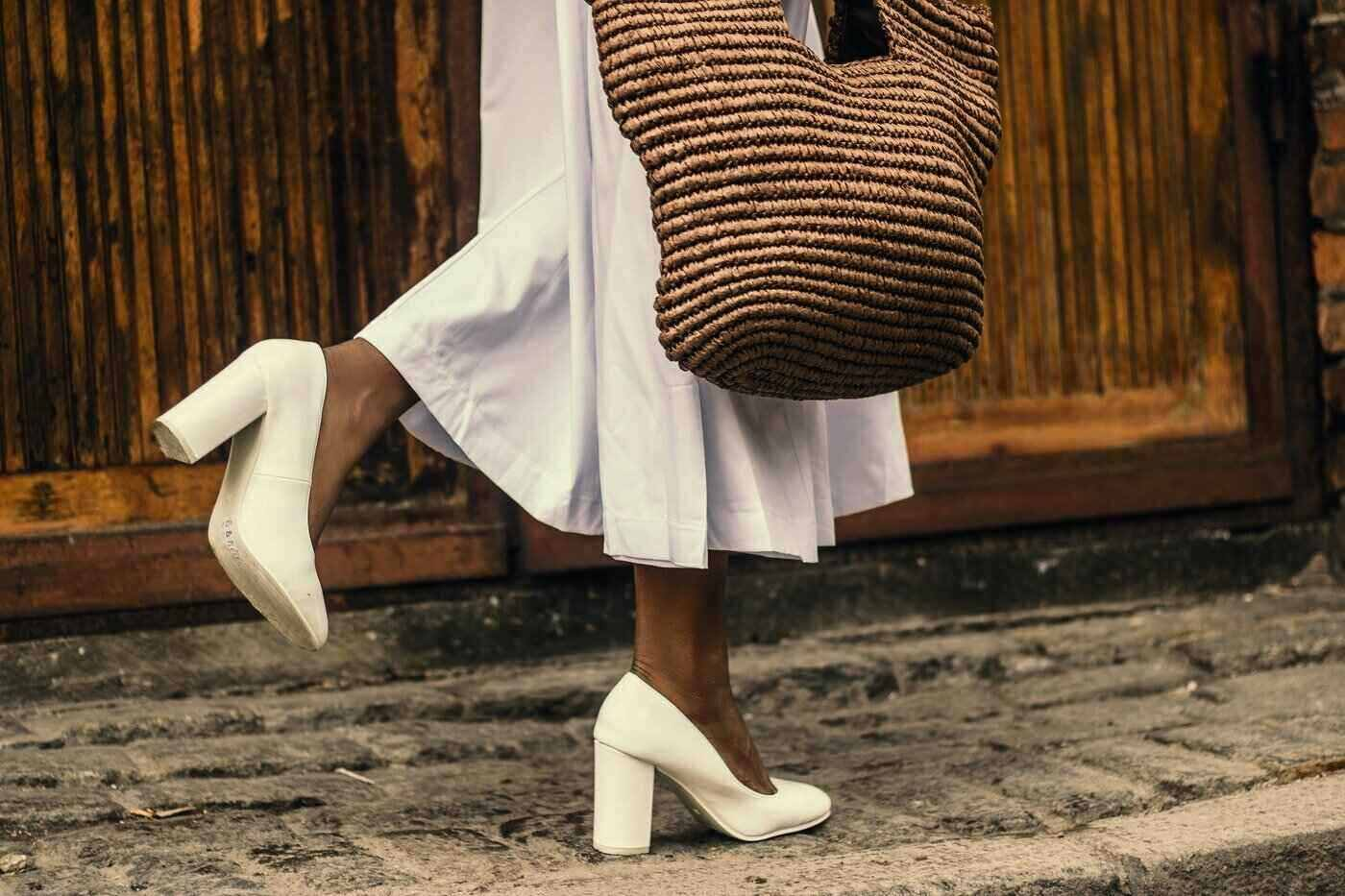 close up of woman's legs walking with high heels and bag - hemp and high fashion