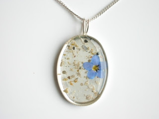 Sterling silver round pendant for ashes and forget me not flower