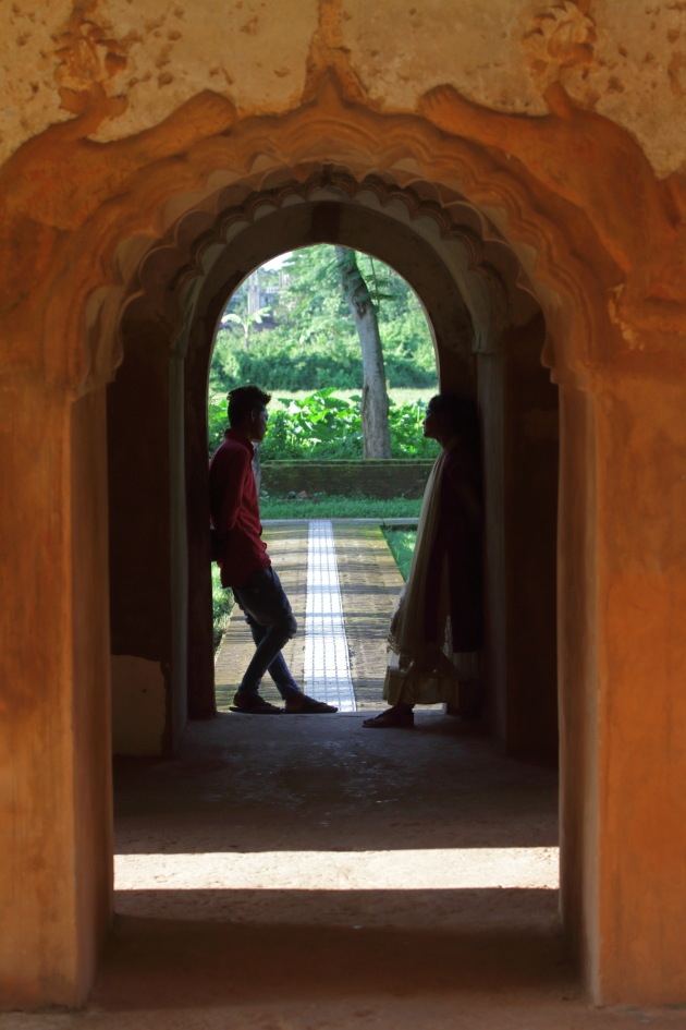 A couple next to the ancient walls of Rang Ghar, Sibsagar, India