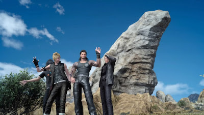 Screenshot of Promoto, Gladiolus, and Ignis posing for the camera, with Noctis hidden behind them.