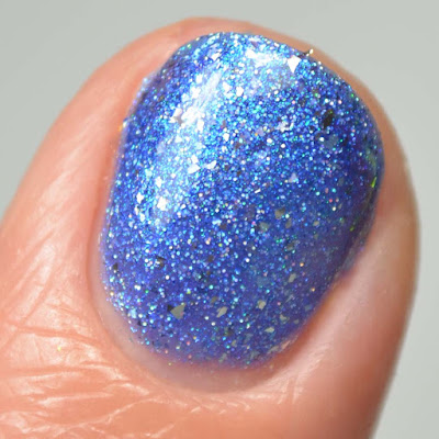 blue metallic nail polish close up swatch