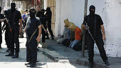 Executing alleged collaborators with Israel in Gaza city in August 2014