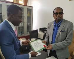 Giving certificate of return to Uche ogah