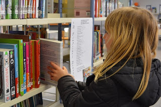 Girl choosing library item