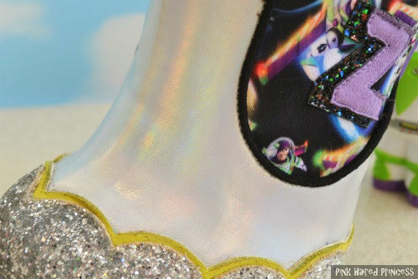 close up of rainbow holographic silver material on ankle boot
