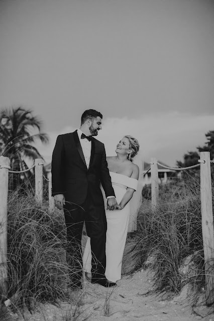 Photography of bride and groom candidly walking on the beach.