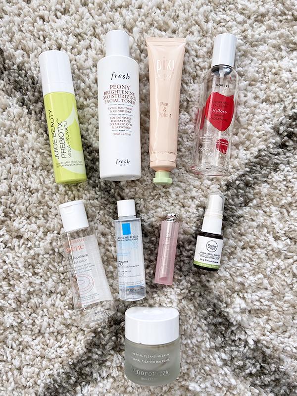 Empty skincare products from Juice Beauty, Pixi, Fresh, Korres, Avene, La Roche Posay, Dior, Rocky Mountain Soap Company, Omorovicza