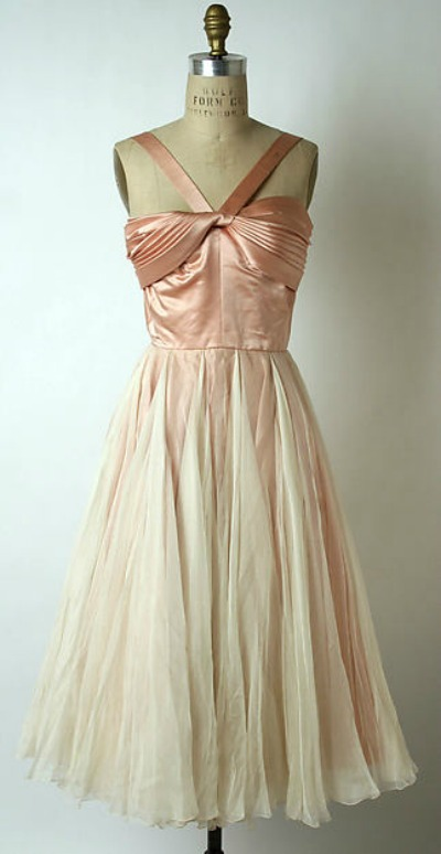 Norman Norell designed pink satin and chiffon halter dress displayed on dress form