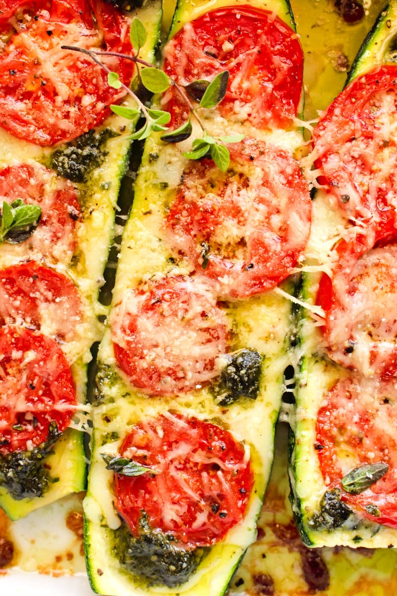Close up top view of one Tomato and Pesto Stuffed Zucchini Boat.