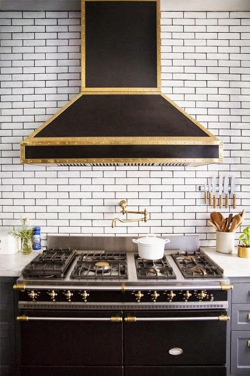 Black Range Hood In White Kitchen