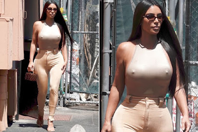 Kim Kardashian goes braless and flaunts her juicy breast nipples in brown nude leather bodysuit