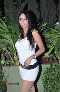 Actress Model Pooja Sri Stills in White Short Dress at F Club pre soft Launch  0053.JPG