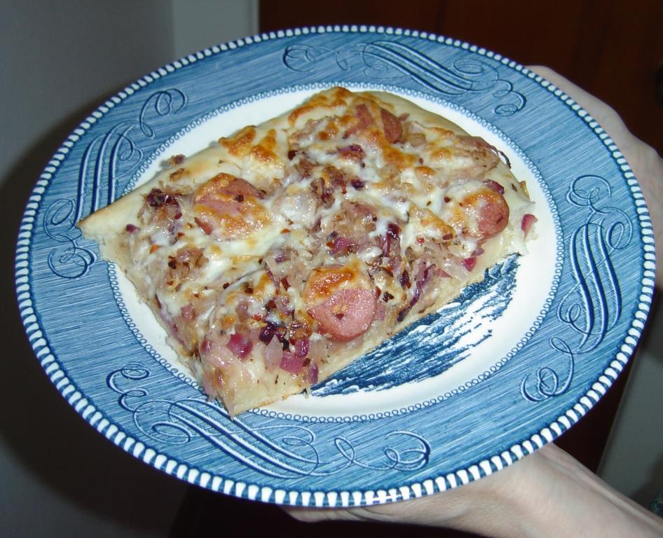Closeup of piece of Bavarian Pizza