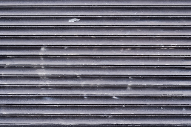 Black painted metal pull down shutter texture