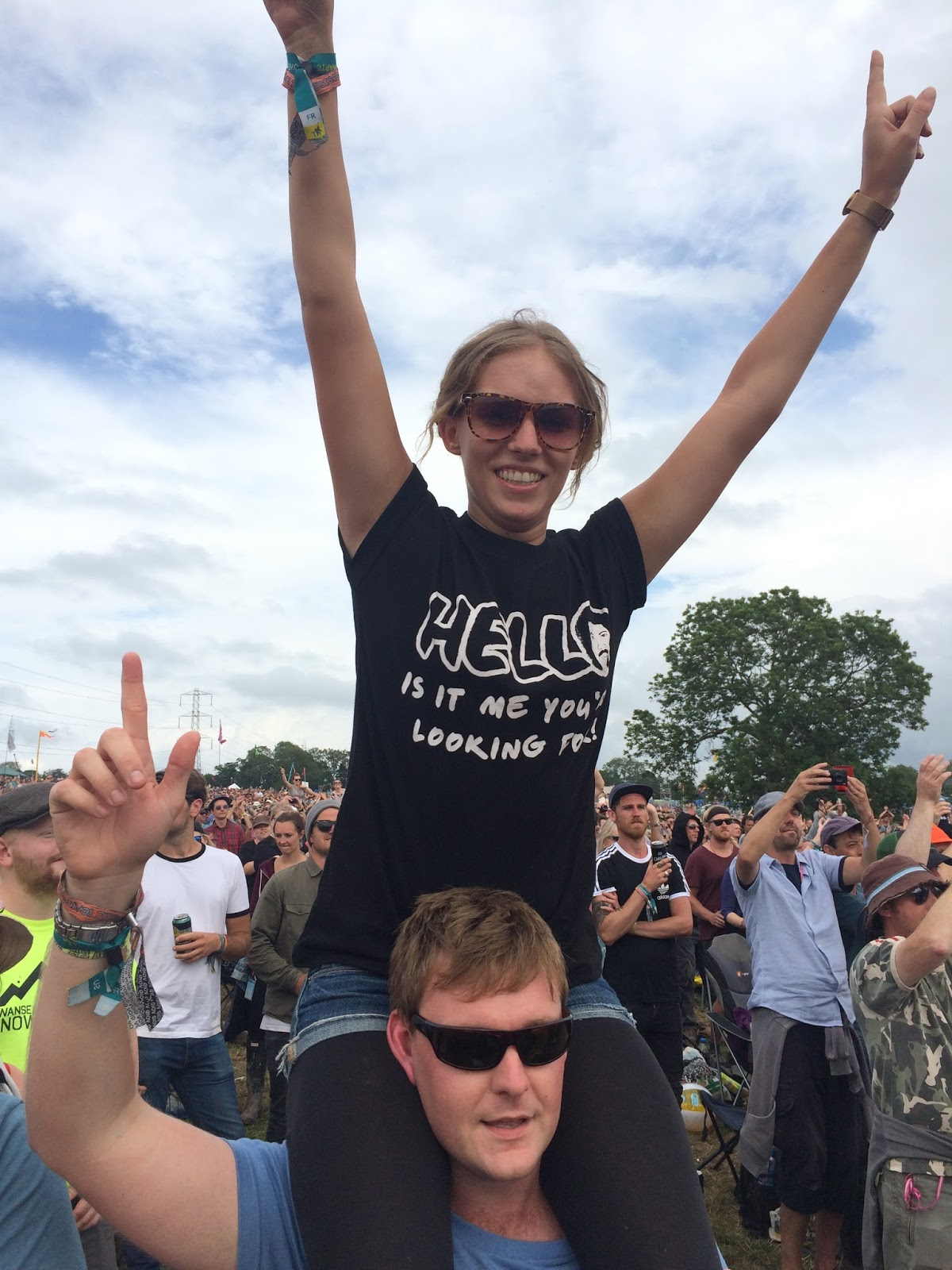 Rachel Emily wearing a Lionel Ritchie T-shirt dancing on shoulders at the Pyramid Stage
