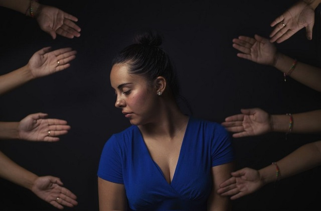 woman ignoring helping hands